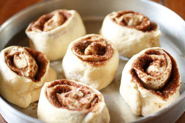 Cinnamon Rolls in a round pan before rising.
