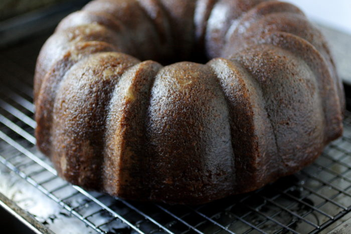 Lemon bundt cake with ginger and black pepper on a rack