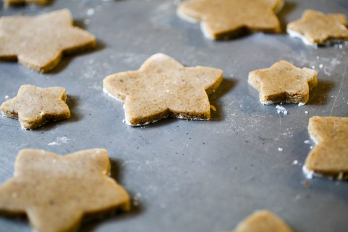 Brown Butter Spice Cutout Cookies star cookies on a cookie sheet.