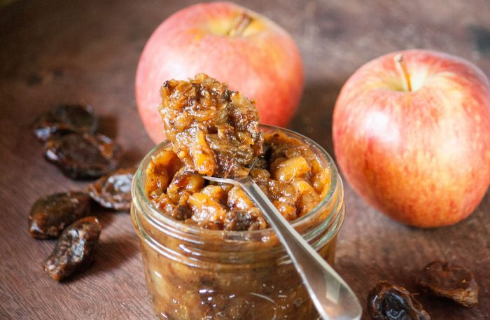 Homemade Apple and Date Chutney in a jar with 2 apples behind it