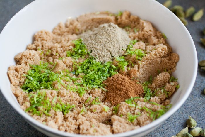 small white bowl with brown sugar, lime zest, cardamom and cinnamon