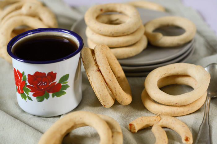 cup of coffee with cuñapé surrounding it