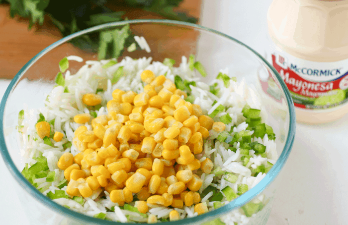 bowl with rice, corn, mayo on the side