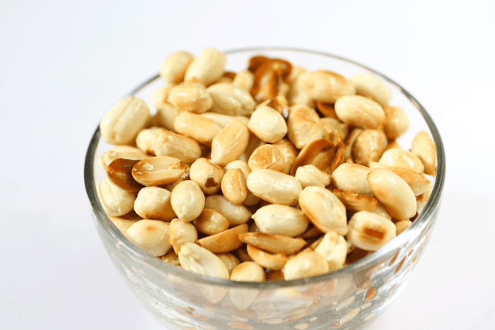 roasted peanuts in a clear bowl