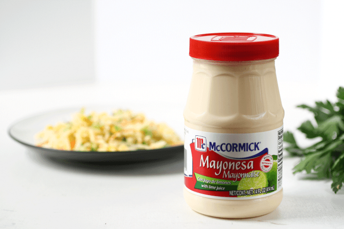 a jar of mayo, behind it a plate with Paraguayan rice salad
