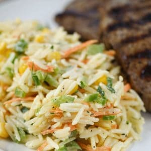 close up of rice salad and steak