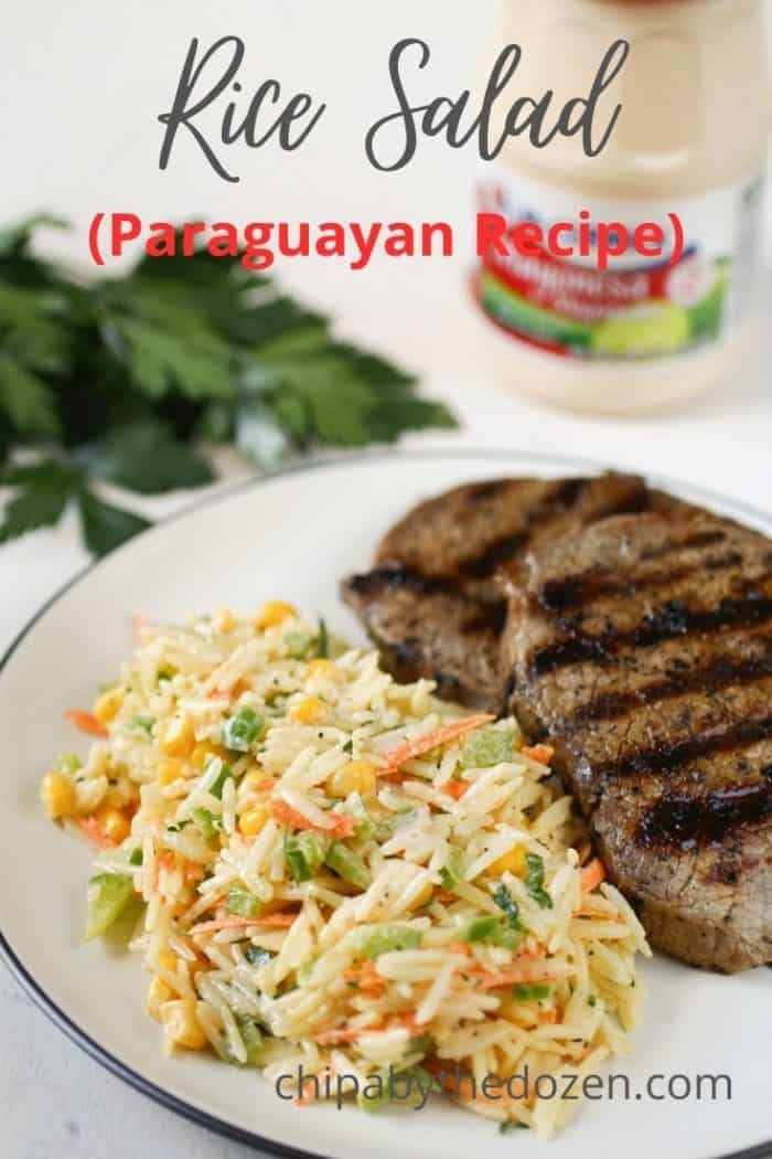 plate with rice salad and a steak