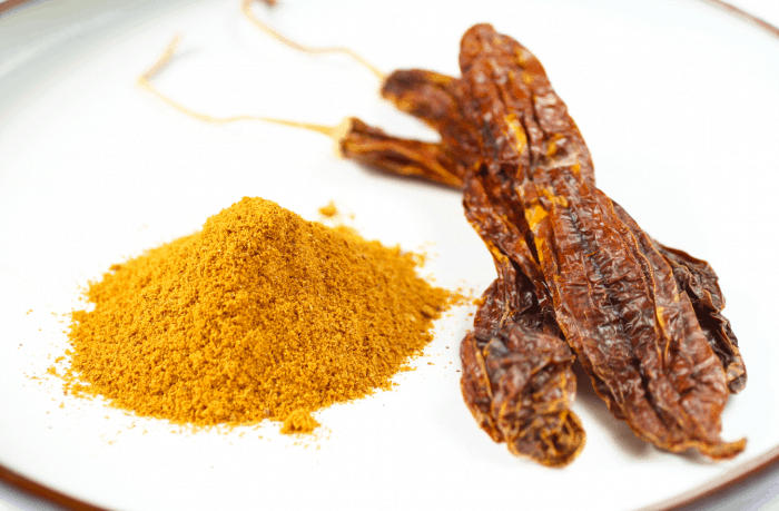 ground yello chilli pepper, and dried Bolivian chilli pepper on a plate