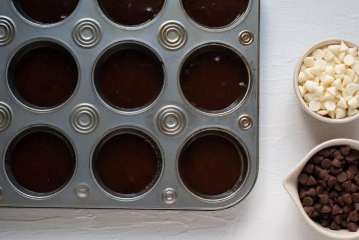 brownie batter in a muffin tin