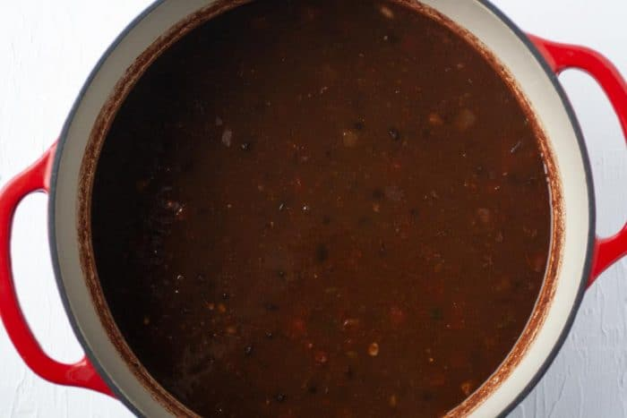 pot with black bean soup with salsa